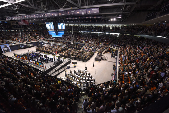 A photo showing the inside of Auburn Arena filled with graduates and guests.