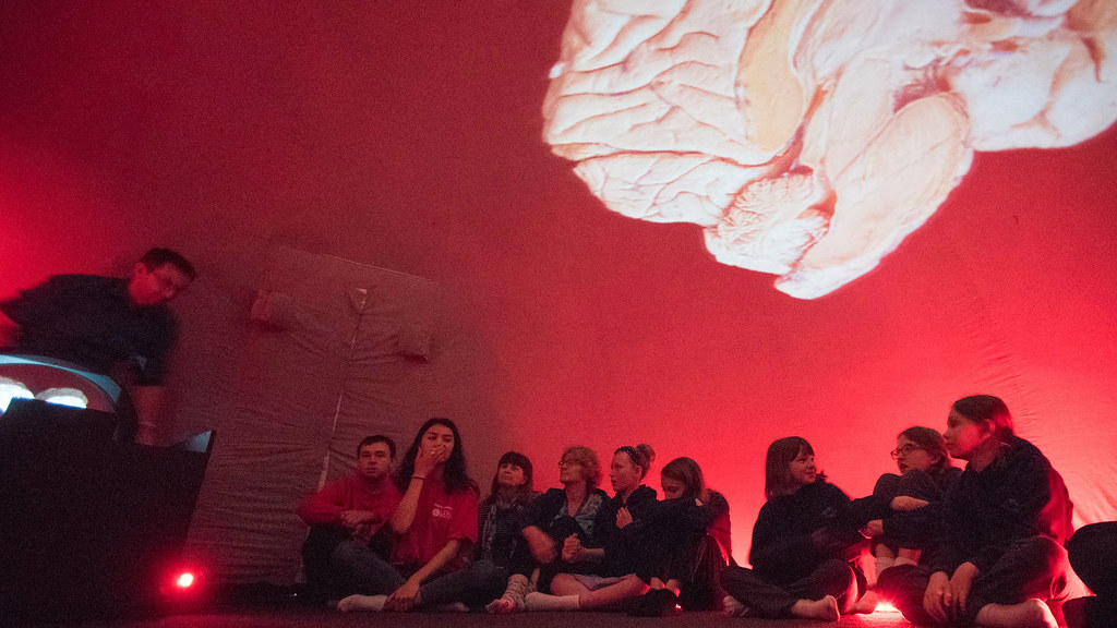 A group of primary school students inside the Discovery Dome taking part in The Brain show.