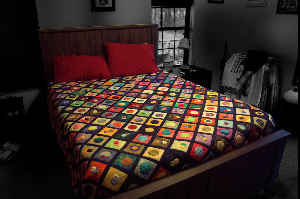 """Today's photo: The Final Frontier – The """"planet"""" looking circles in this quilt inspired its Star Trek based name. (photo taken with Pentax K-3 II; selective coloring and other photo editing with PaintShop Pro)."""