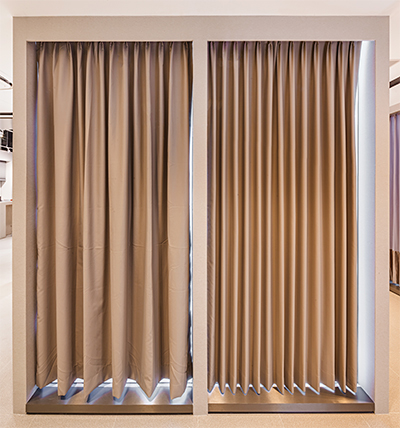 Curtain-shaping technology (right) keeps curtains looking tidily folded all the time.