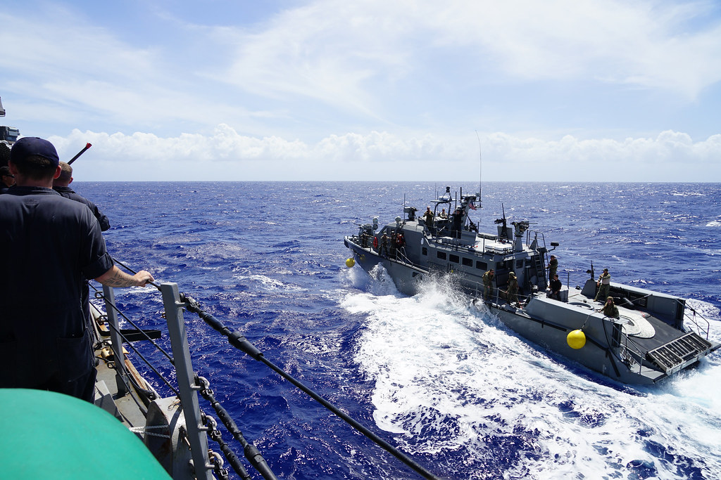 GUAM -- Deployed Guided Missile Destroyer USS O'Kane (DDG 77) joined with Mark VI Patrol Boats of Coastal Riverine Group-1 Detachment Guam (CRG-1 DET Guam) Feb. 21 to perform integrated exercises off the coast of Guam.