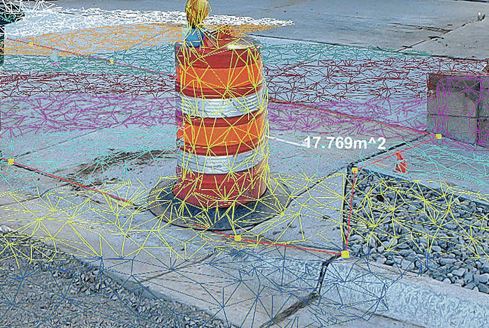 Augmented reality goggles project holograms onto the existing environment to help solve infrastructure challenges such as identifying structural flaws or calculating the total area of a piece of infrastructure like a sidewalk.
