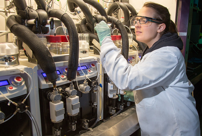 Christina Hanson, a graduate student with MPA-CINT, inspects the reactor