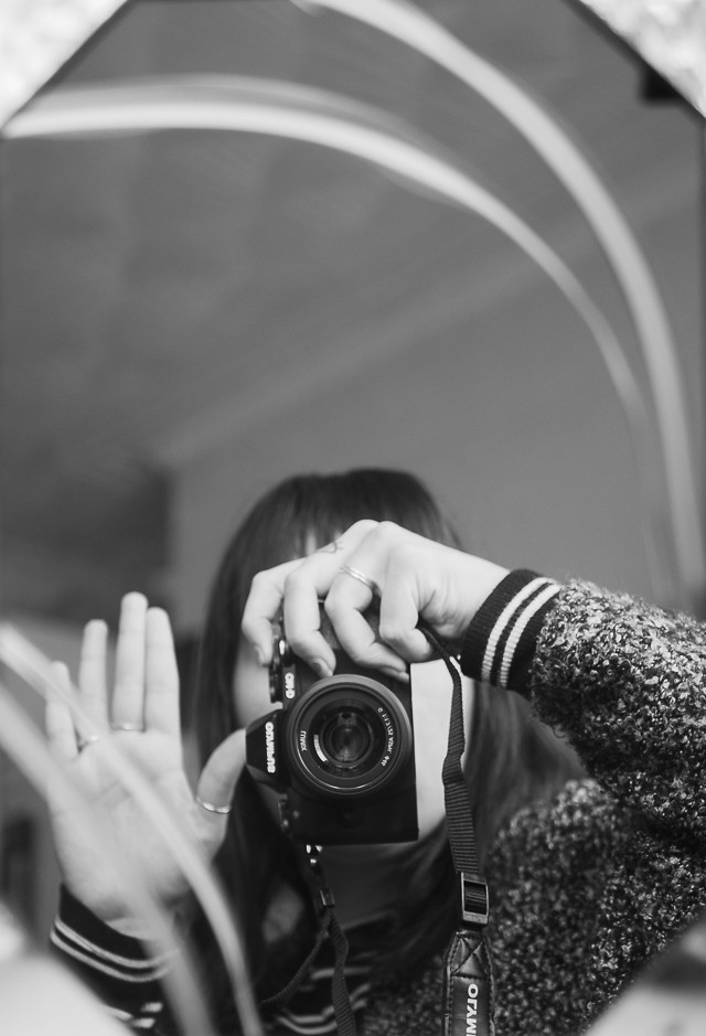 black and white self portrait in mirror
