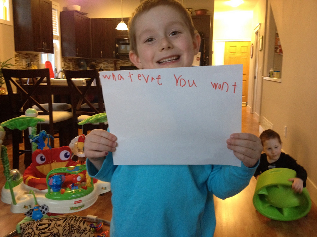 "Son holding sign that says ""whatever you want"""