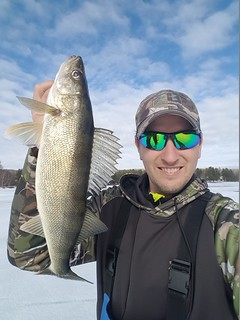 Photo of Matt Sell holding up walleye
