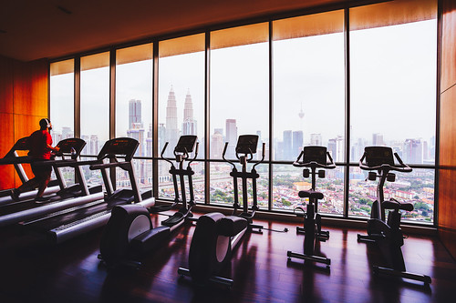Fitness room with cityscape view in background kuala lump
