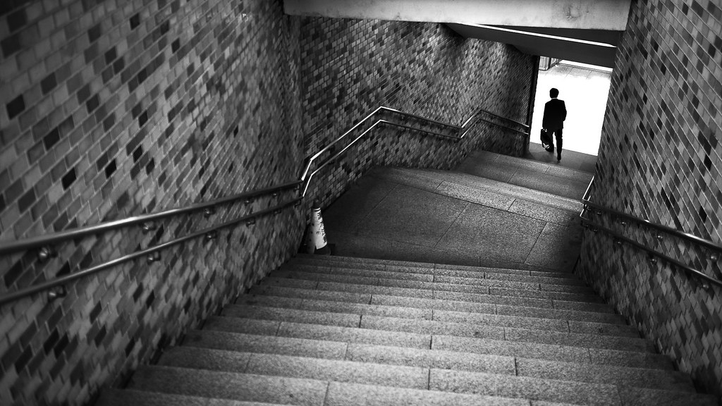 Stairs to subway tokyo japan black and white street photography by giuseppe