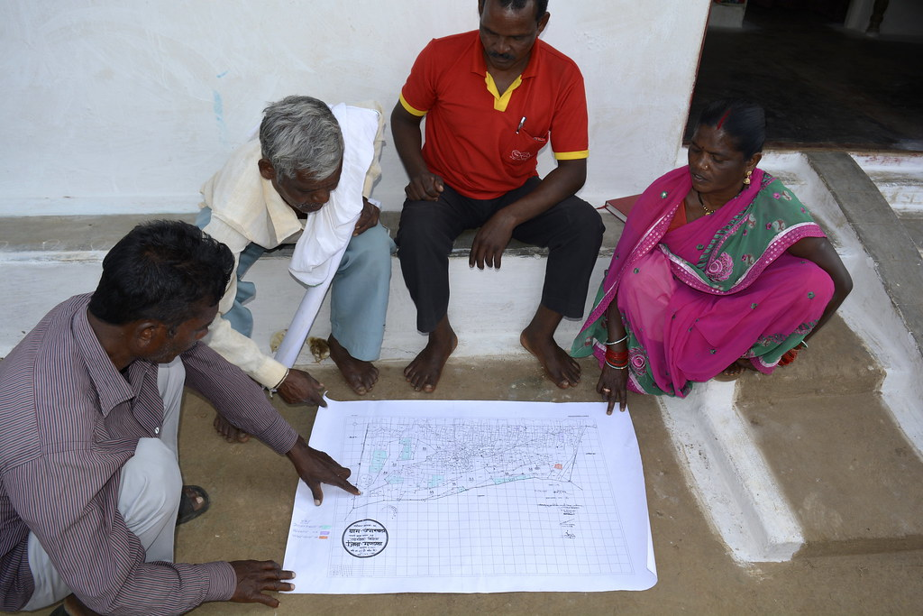 Farmers looking at the revenue map of their farms at Umarwada village.