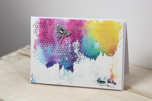 How to use Distress Oxides – technique 5 - swiping the page through ink and water. Finished card with grungy honeycomb and a mixed media feel