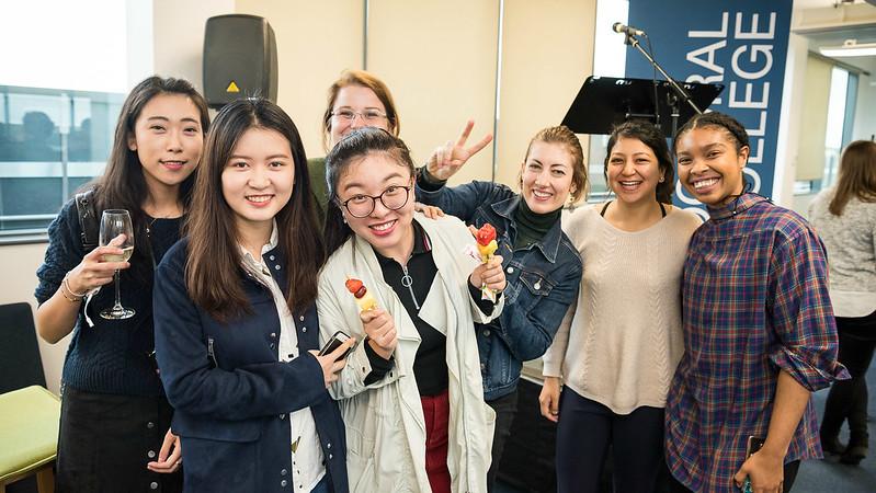 Postgraduate students socialising over coffee