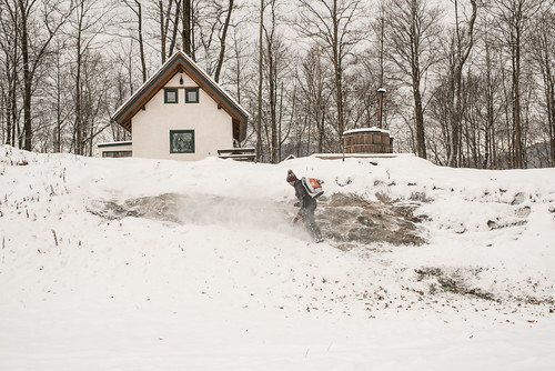 "Tyler Leaf-Blowing Snow off of Rocky ""Staircase"" to Cottage 