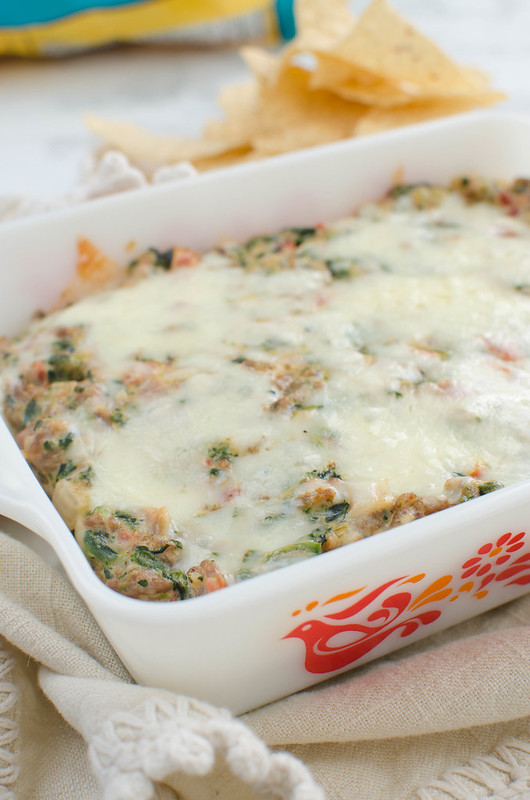 Cheesy Sausage and Spinach Dip - gooey cheese dip with sausage, Rotel, and spinach! It's always a party favorite!