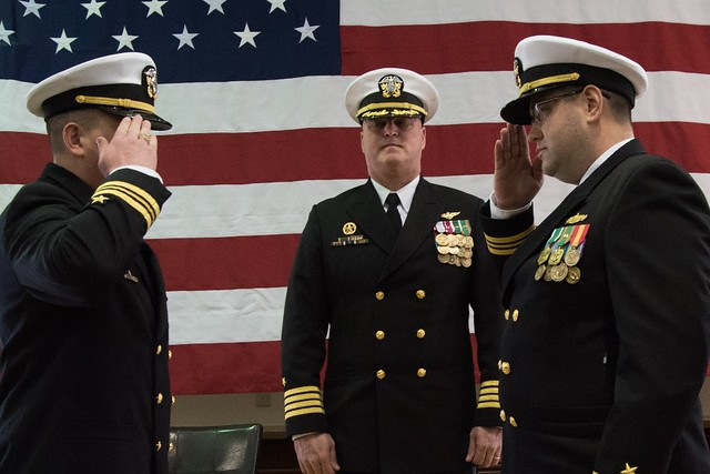SASEBO, Japan - Lt. Cmdr. William Carroll (left), from Lusby, Md., salutes Lt. Cmdr. Benjamin Pearlswig (right), from Turner, Ore., during a change of command ceremony.