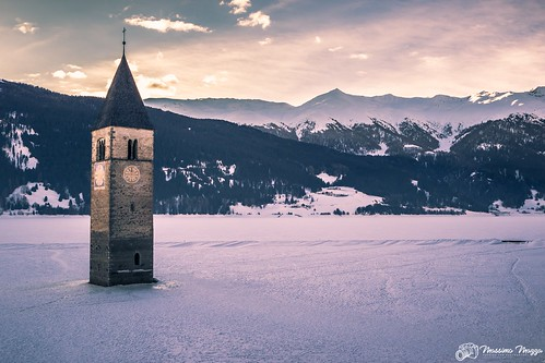 The submerged bell tower out from the frozen lake Resia | by Massimo Mazza Photography