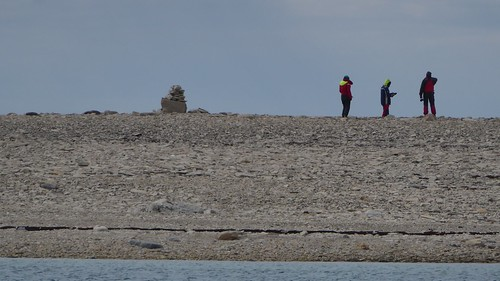 Neighbors ashore with cairn | by Sailing P & G
