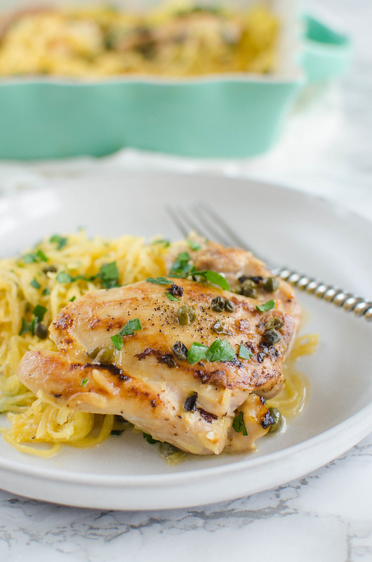 Paleo Chicken Piccata - chicken thighs with a delicious lemon and caper sauce, served over spaghetti squash. You're going to love this healthier version of the classic!