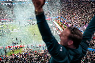 An Eagles fan celebrates as confetti falls on the field at Super Bowl LII, Minneapolis MN | by Lorie Shaull