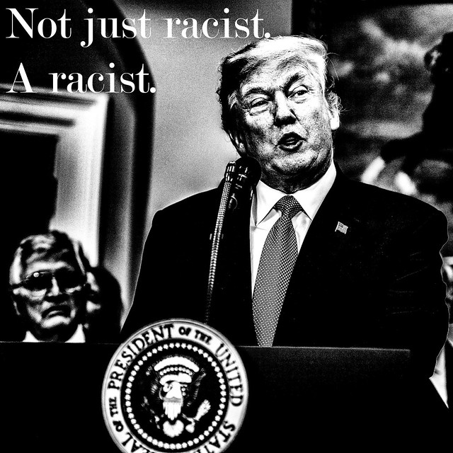 "A picture of Trump at a lectern. Text on the picture says ""Not just racist. A racist."""