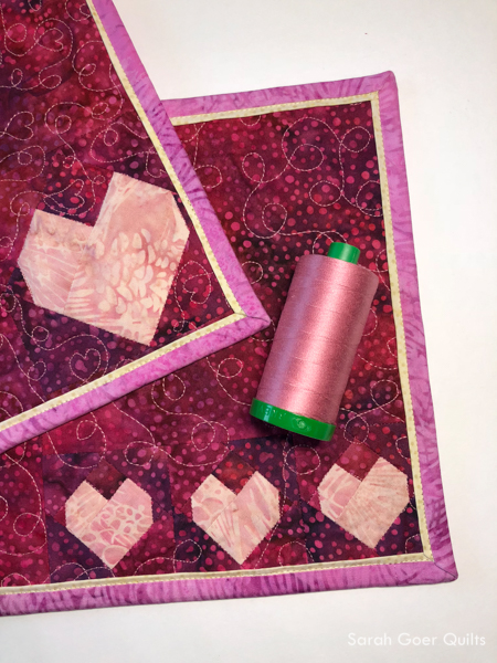 #islandbatikambassador #islandbatik #aurifil Antique Rose thread was used for free motion quilting.