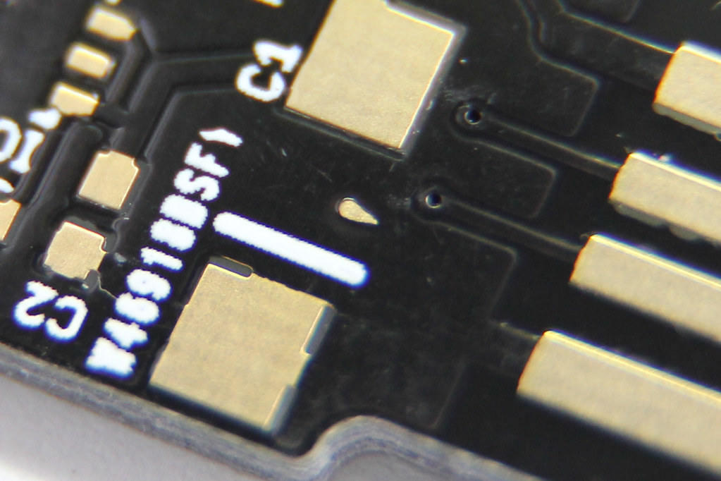 close-up photo of PCB with random exposed copper