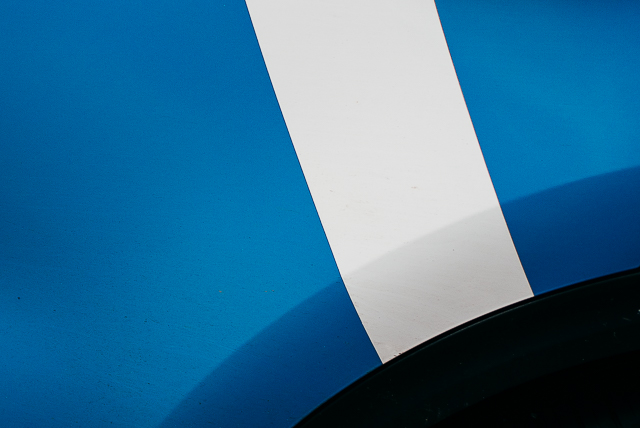 close up of blue and white car