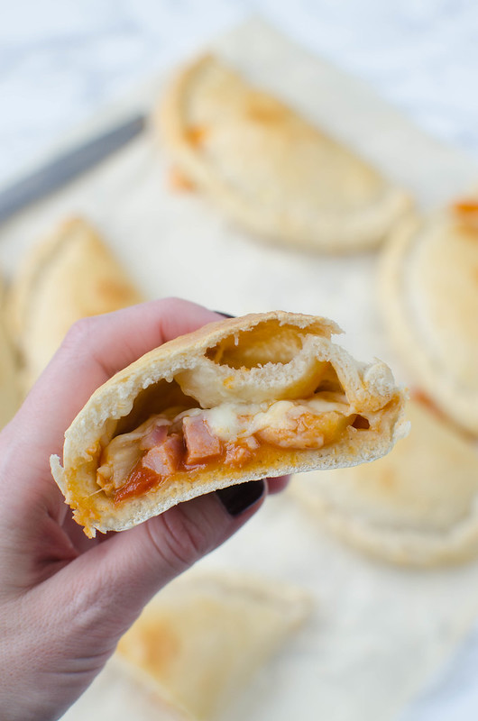 Mini Hawaiian Calzones - easy homemade calzones filled with ham, pineapple, red onion, and mozzarella cheese! The perfect way to switch up pizza night!