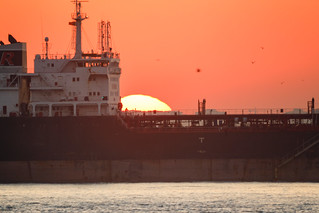Cargo Ship Close-up by Setting Sun | by kaansidekick