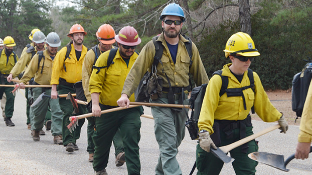 Firefighters walking to a training site at the Solon Dixon Forestry Education Center.