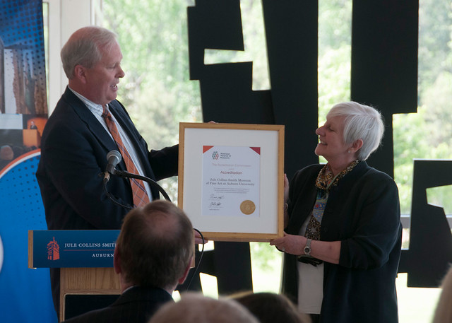 : Jule Collins Smith Museum director Marilyn Laufer accepting certificate commemorating the museum's accreditation.