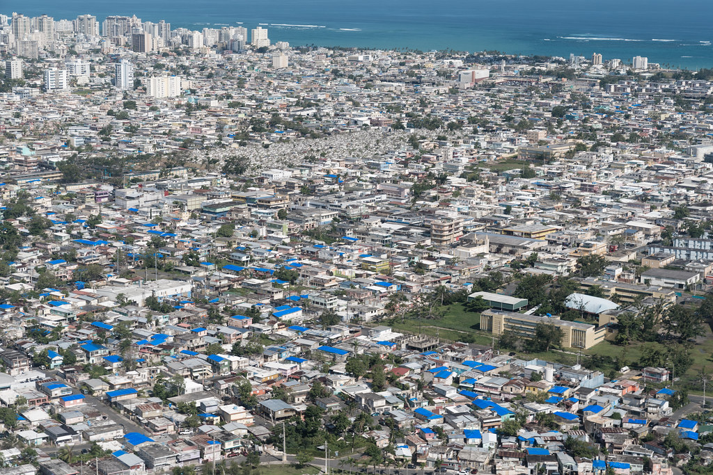 Blue Tarps Cover Damaged Roofs In San Juan Puerto Rico Se