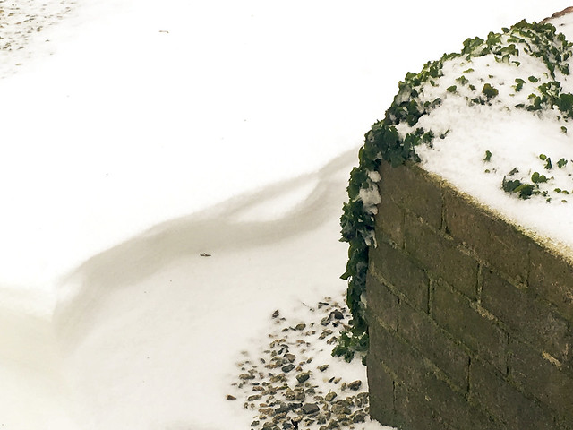 Drifted snow by a wall