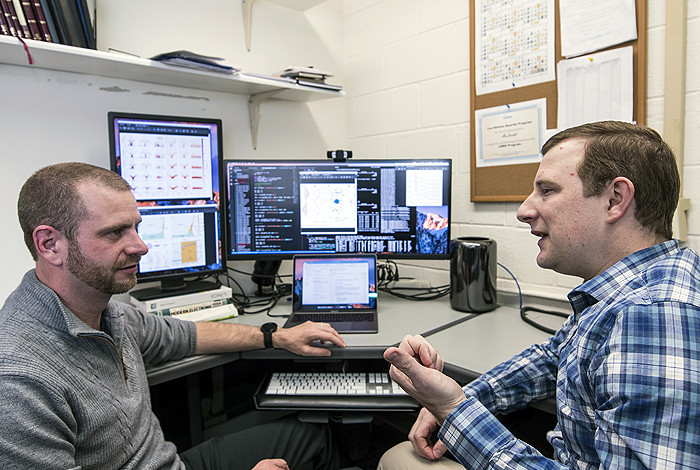 Marc Janoschek, left, and David Fobes discuss features of quantum materials.
