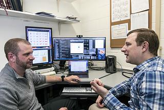 Marc Janoschek, left, and David Fobes discuss features of quantum materials.