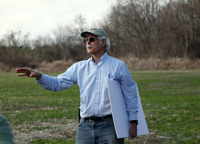 Skip Hyberg, Senior Economist, USDA Farm Service Agency, standing in front of an edge of field conservation practice