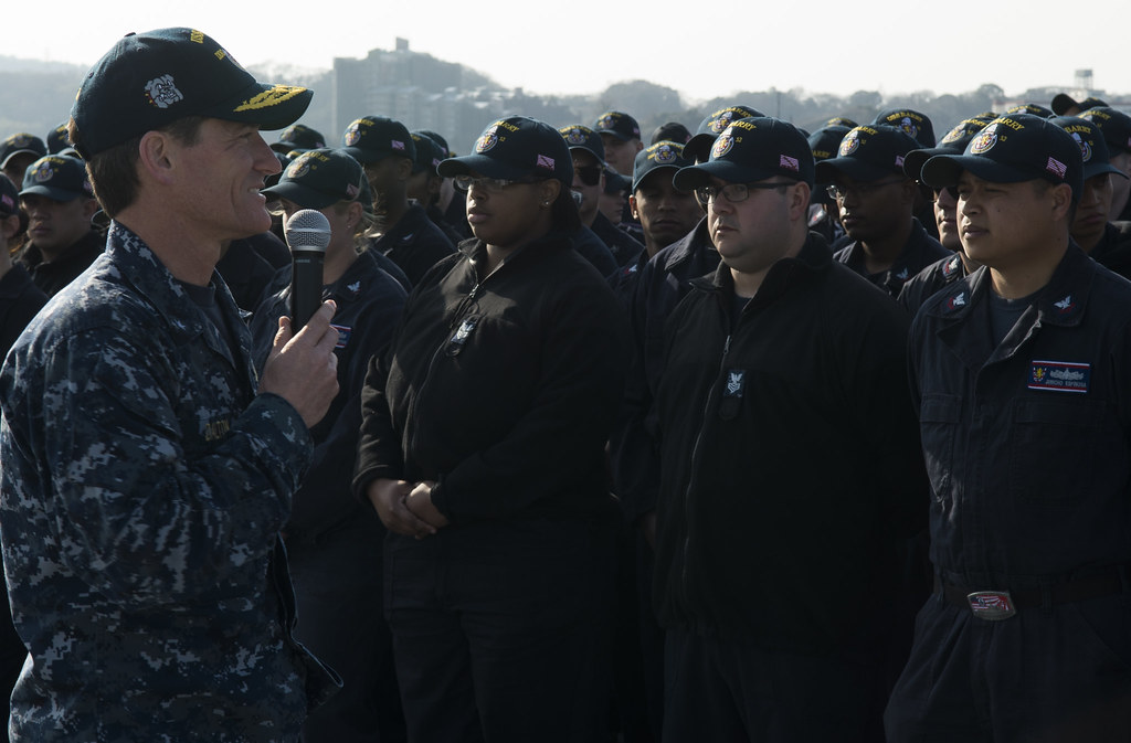 Rear Admiral Marc Dalton, Commander, Task Force 70, conducts an All-Hands call on the U.S. Navy barge (APL 40) with the crew of the Arleigh Burke-class guided missile destroyer USS Barry (DDG 52).