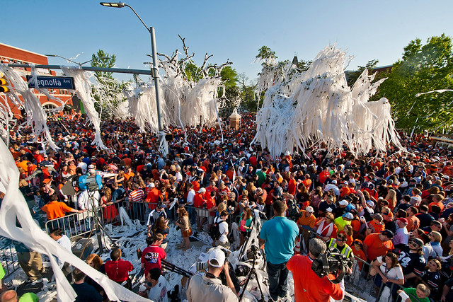 A crowd of Auburn fans fills Toomer's Corner for the rolling of the Toomer's Corner oaks.