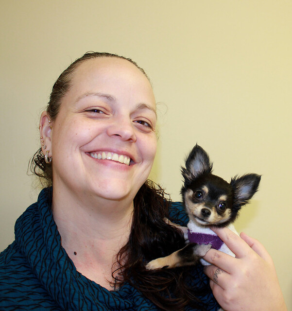 Jennifer Glover of Seattle holds her dog, Luna