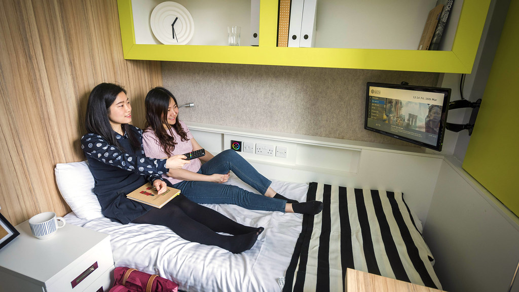 Students in a bedroom in The Quads