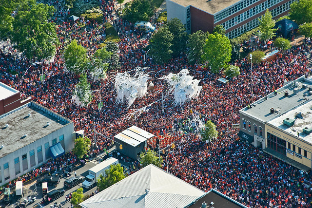 An aerial photo shows a crowd of Auburn fans filling Toomer's Corner.