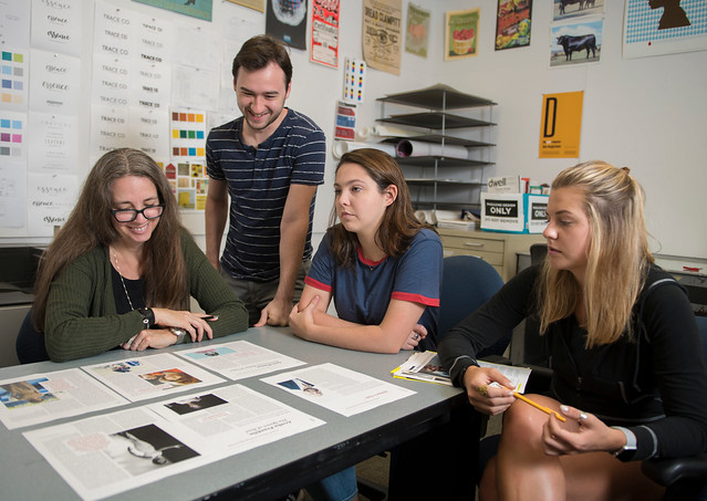 Kelly Bryant, professor of graphic design in Auburn's College of Architecture, Design and Construction, works with students during a design class.