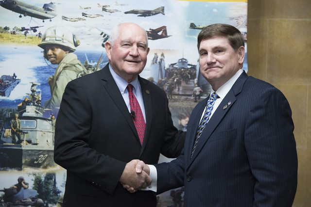 Secretary Sonny Perdue shaking hands with Larry Brom, the Director for Plans & Operations from the Vietnam War Commemoration