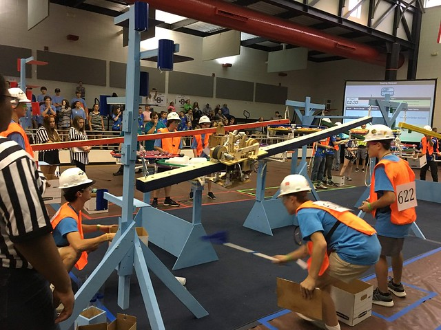 Students work to build robots as part of this year's BEST Robotics competition.