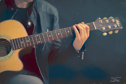 Digital Art image of a person playing guitar