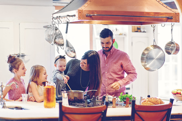 Family in kitchen preparing holiday meal