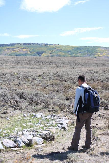 A man standing near rock