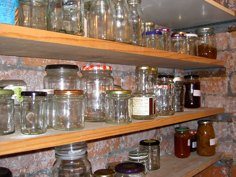 Jars with lids on larder shelf