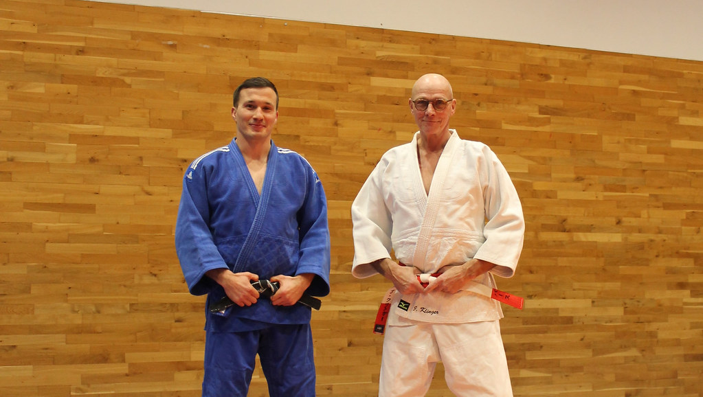 Jan Gosiewski and Juergen Klinger wearing judo jackets in the dojo
