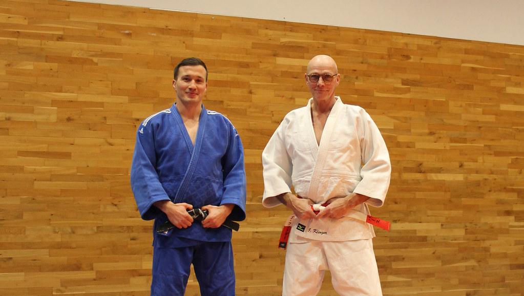 Jan Gosiewski and Juergen Klinger wearing judo jackets in the dojo