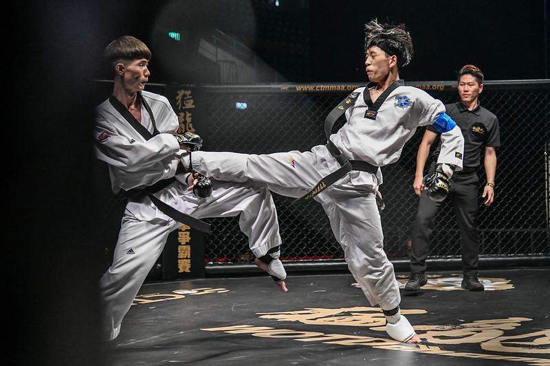 陳昕(右)2度奪下54公斤級盟主。(大會提供)